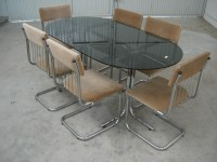 conjunto mesa y sillas 700 €